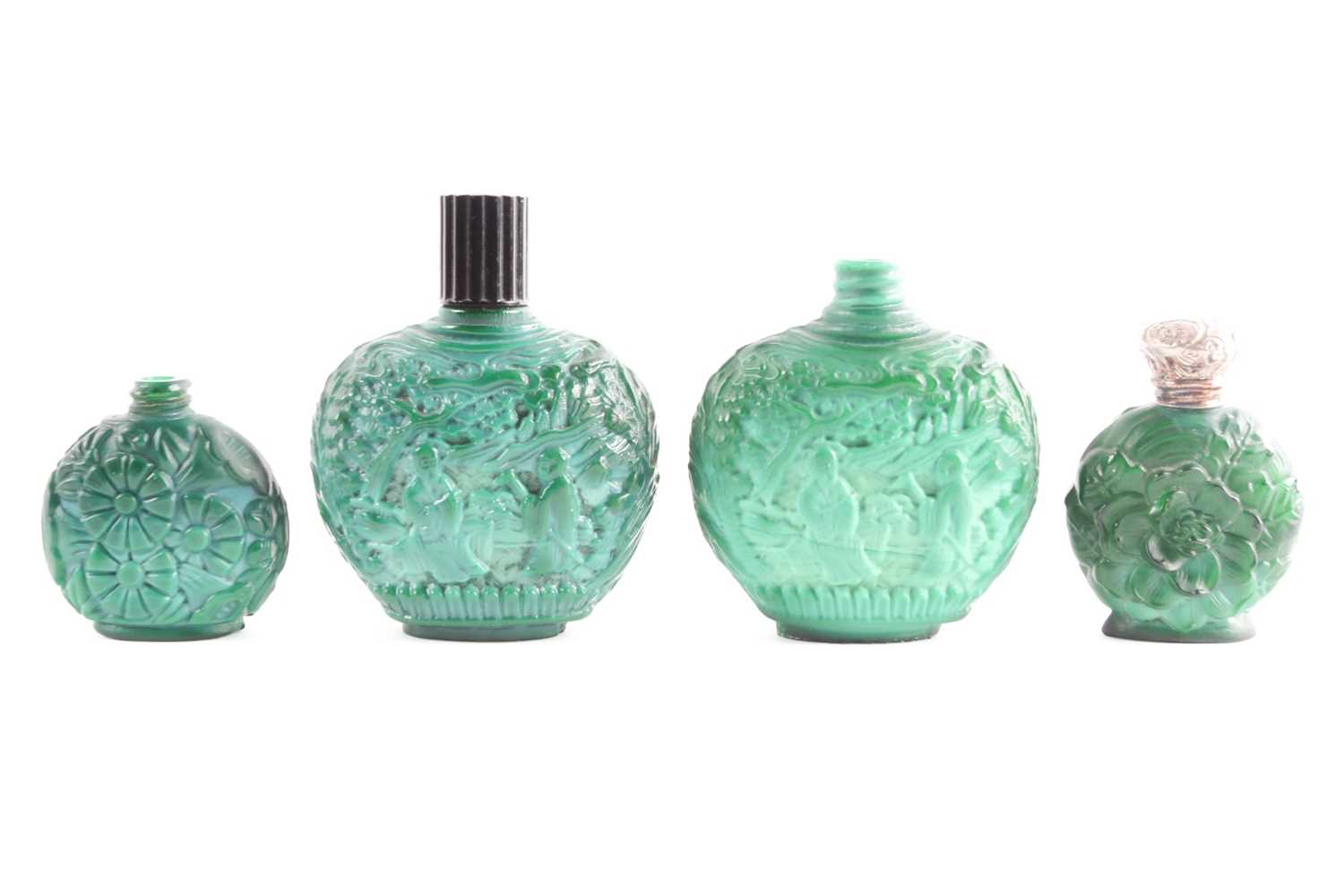 A collection of four carved and moulded green glass scent bottles; carved with scenes from rural - Image 3 of 3