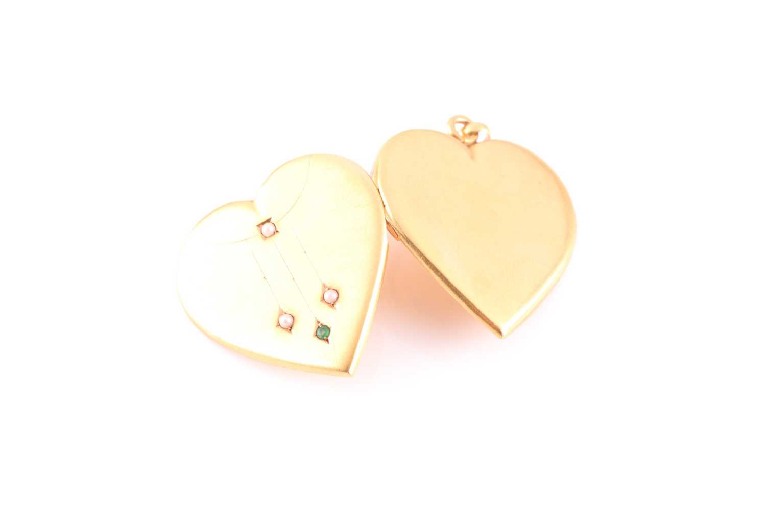 An early 20th century yellow metal heart-shaped locket pendant, the hinged front inset with small - Image 3 of 5