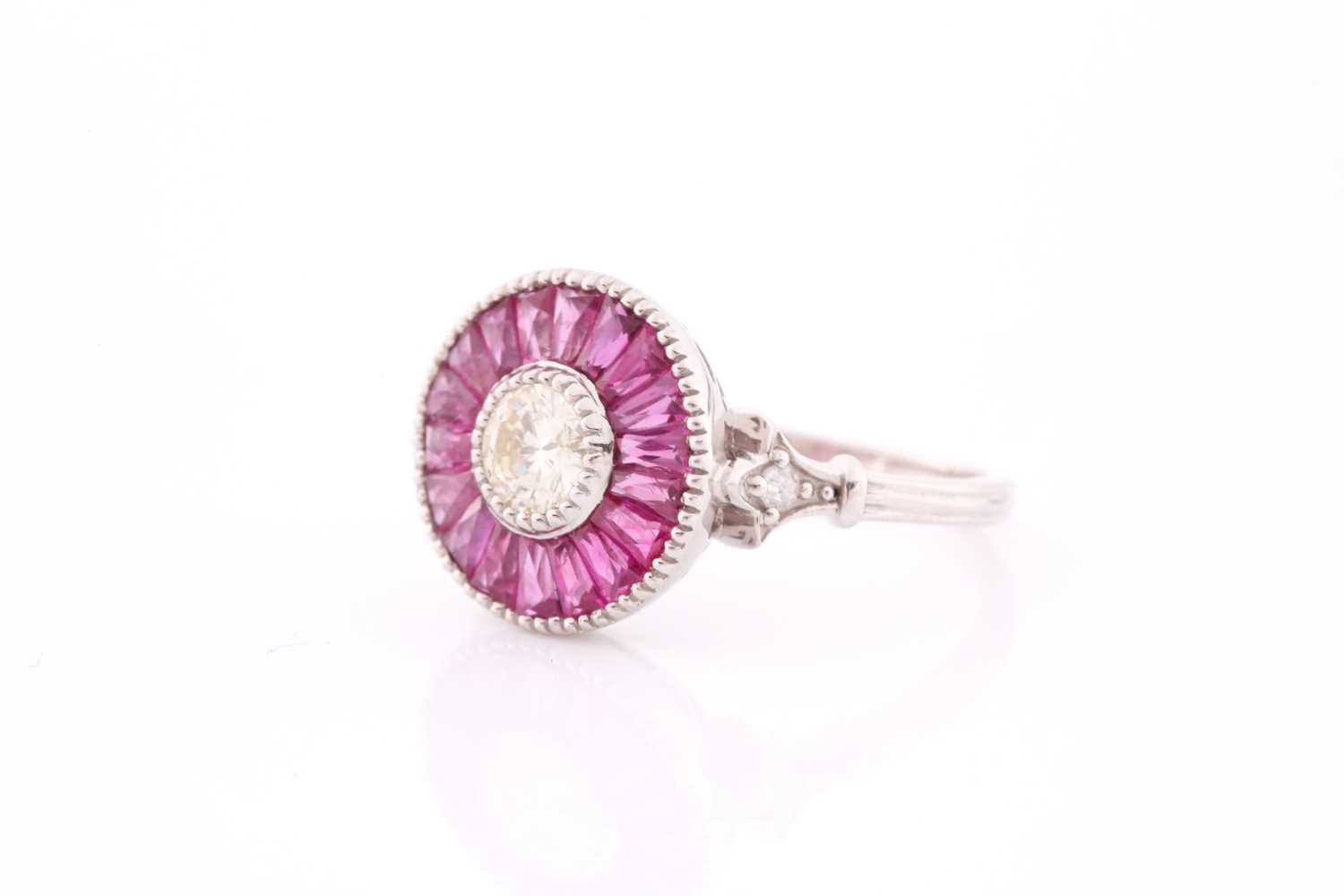 A diamond and ruby target ring, in the Art Deco style, centred with a round brilliant-cut diamond, - Image 3 of 4