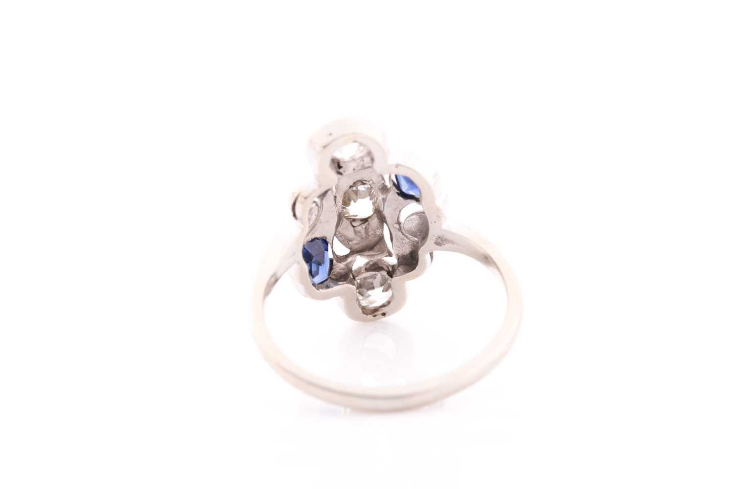A diamond and sapphire ring, in the Art Nouveau style, the stylised mount inset with old Mine - Image 3 of 4
