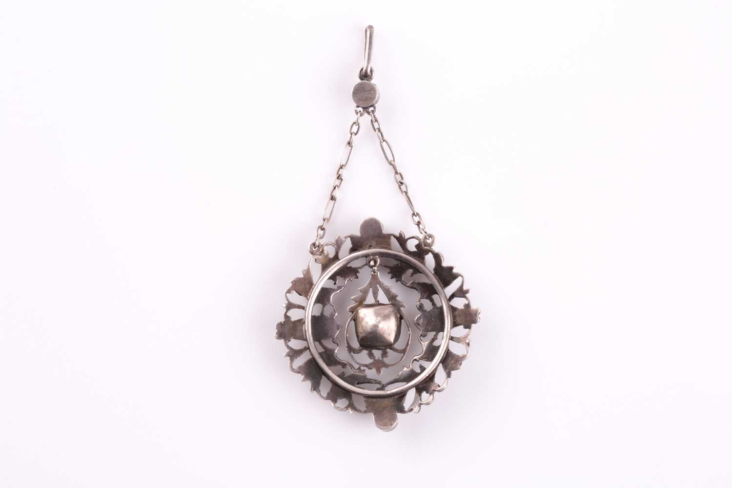 A 19th century white metal and paste pendant, centered with a cushion-cut paste pendant, the - Image 2 of 3