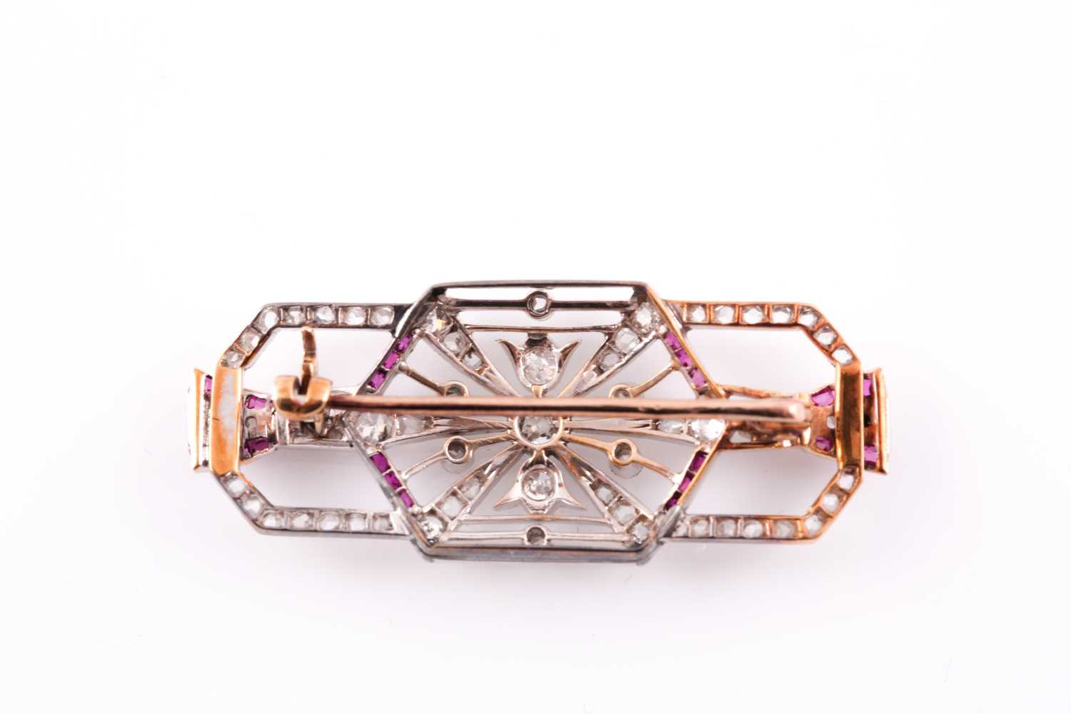 A diamond and ruby plaque brooch, in the Art Deco style, set with round single-cut and rose-cut - Image 2 of 2