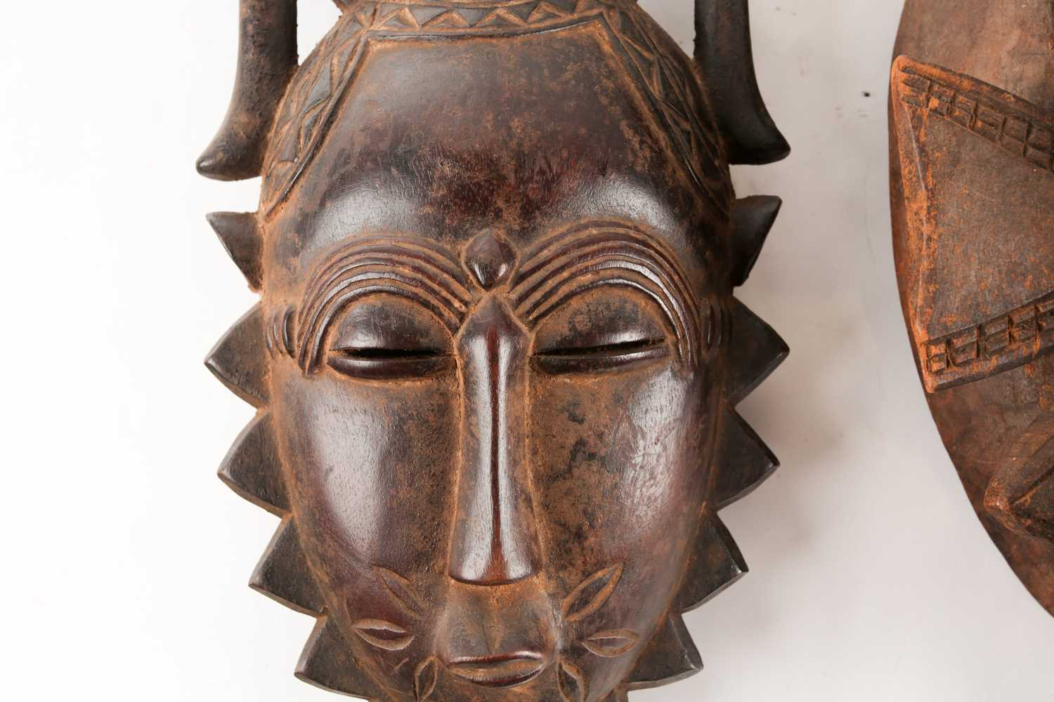 A Senufo Kpelie mask, Ivory Coast, with bird surmount and horns, 34.5cm; and a Yaure mask, Ivory - Image 3 of 4