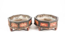 """A pair of Regency style """"Chinoiserie lacquered octagonal jardinieres with faux bamboo moulded panels"""