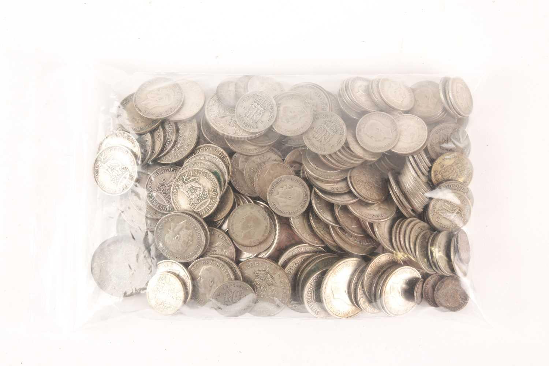A quantity of British silver content coins, 1919 - 1947, comprising 1 half crown, 26 florins, 68