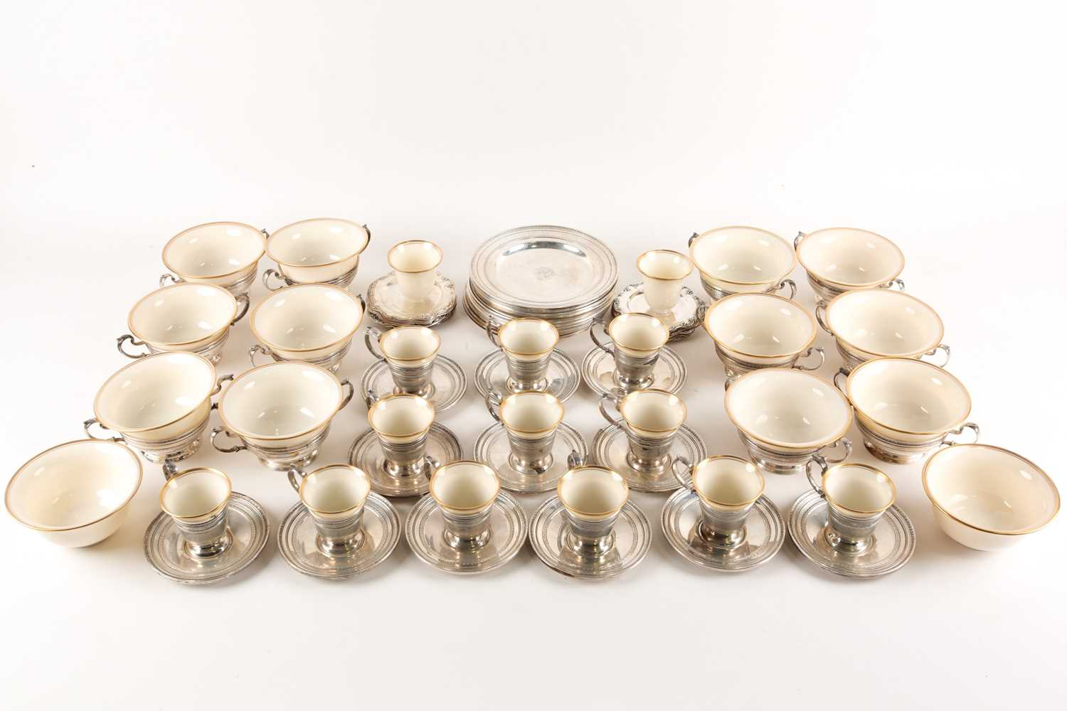 A Lenox Porcelain coffee and dessert service, set in Gorham Sterling Silver mounts, comprising