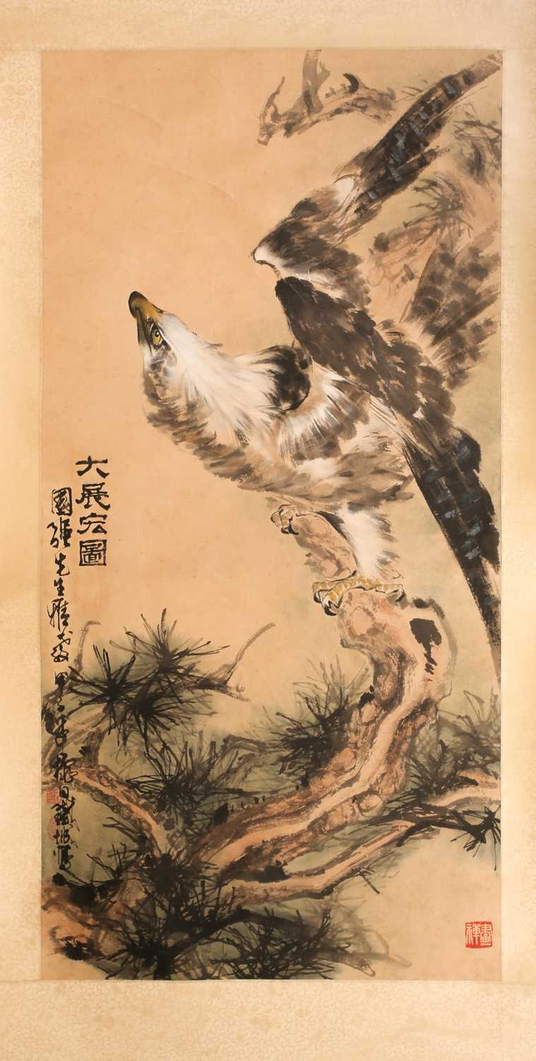 A Chinese hanging scroll, painted with an eagle upon a gnarled pine branch, with three red chop