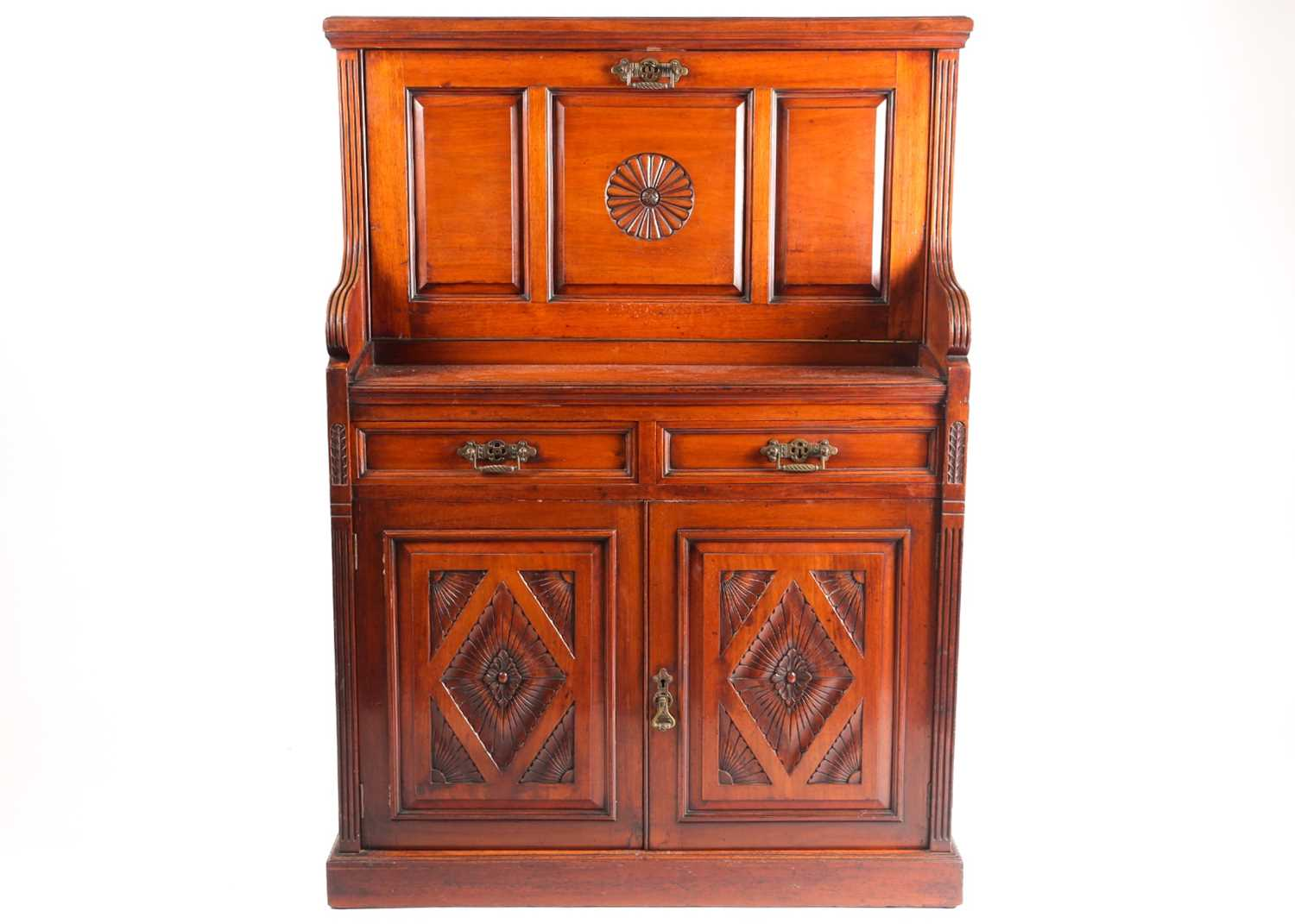 A late 19th-century Aesthetic design walnut fall front secretaire with fitted and leathered