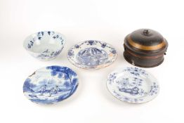 An 18th century delftware bowl and three plates, the bowl and a plate similarly decorated, painted