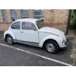 A Volkswagen Beetle white 2-door manual saloon, left-hand drive, 1200cc petrol. Registration A517