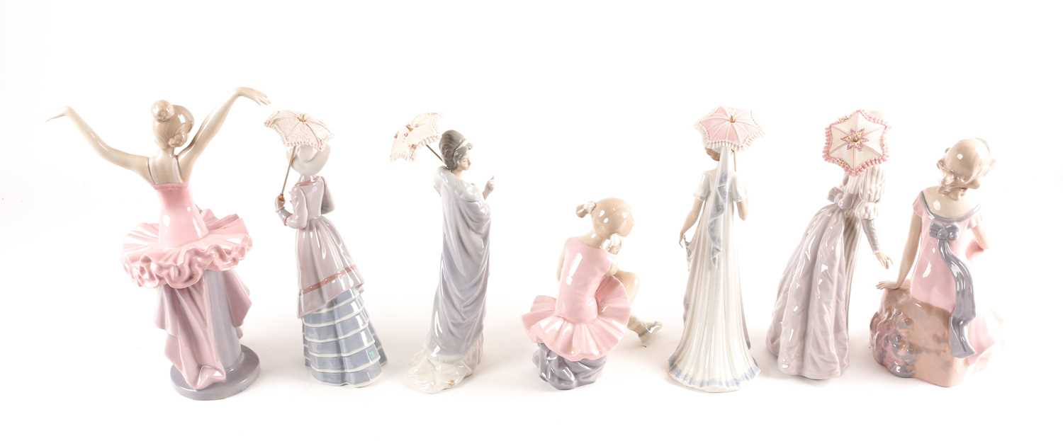 Four Lladro promenading ladies, each with a parasol, and three D'Angila figures, tallest 31. - Image 6 of 10
