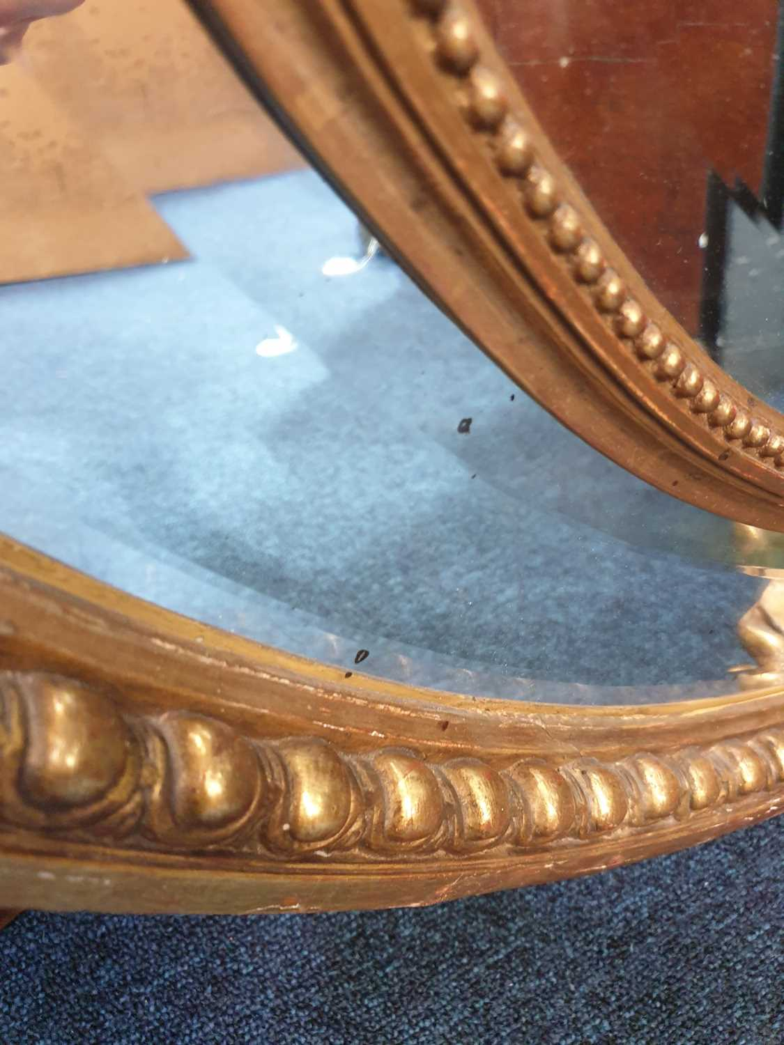 A Victorian carved wood and gilt gesso oval wall mirror with cartouch decoration and an outer border - Image 10 of 10