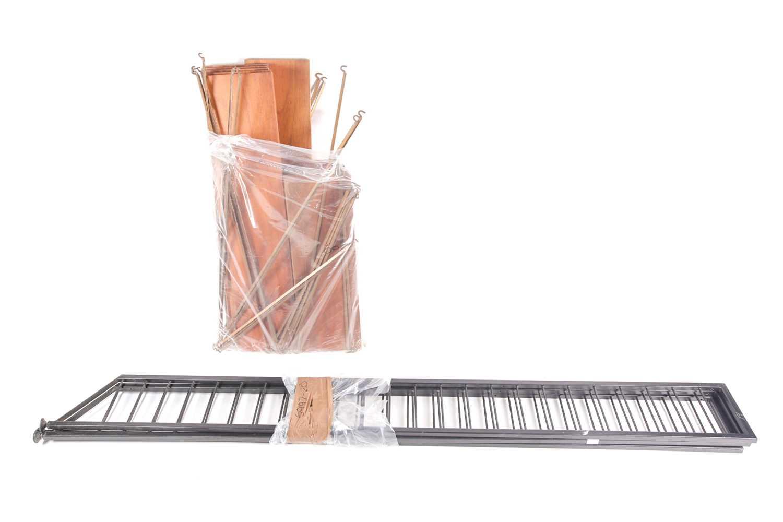 "A black-painted ""Ladderax"" adjustable shelving unit with teak effect shelves, 90 cm wide x 41 cm"