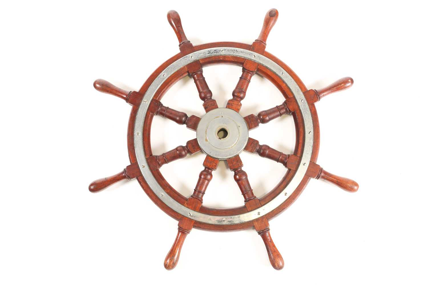 A teak wood ship's wheel with turned spindles and chromium-plated fitments. 77 cm diameter.Condition