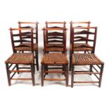 A set of six early 19th-century Macclesfield type ladder back dining chairs with distinctive