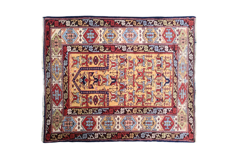 "A 20th-century golden ground Turkish ""Head & Shoulders"" prayer rug. with stylized tulip motifs"