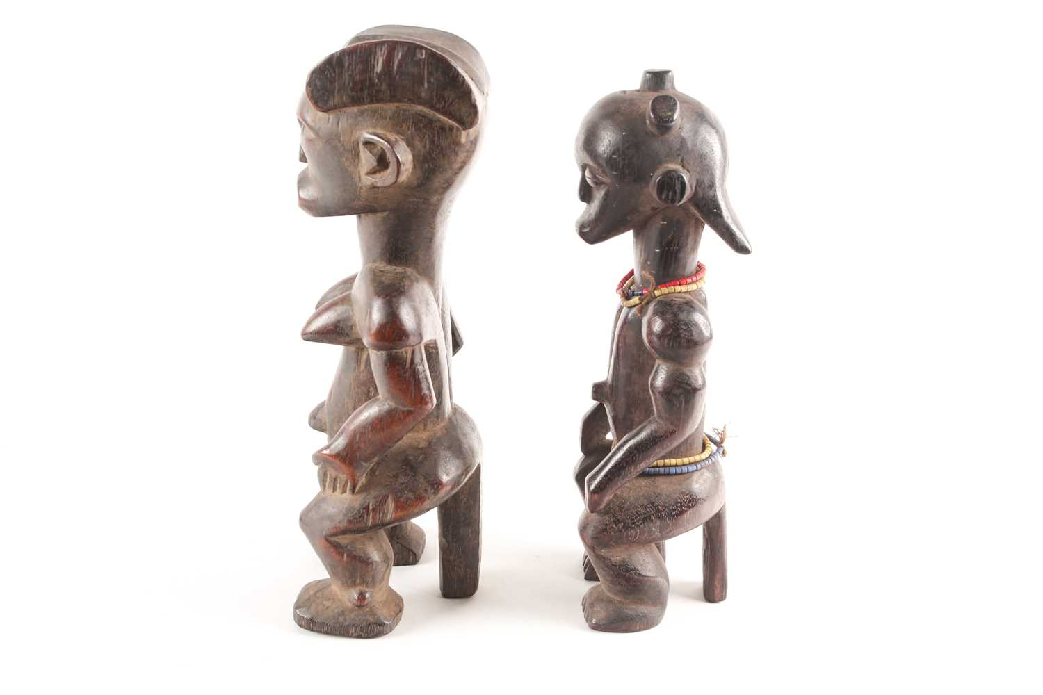 A Fang seated male figure, Gabon, with knotted hair swept out at the rear, seated with his hands - Image 2 of 6