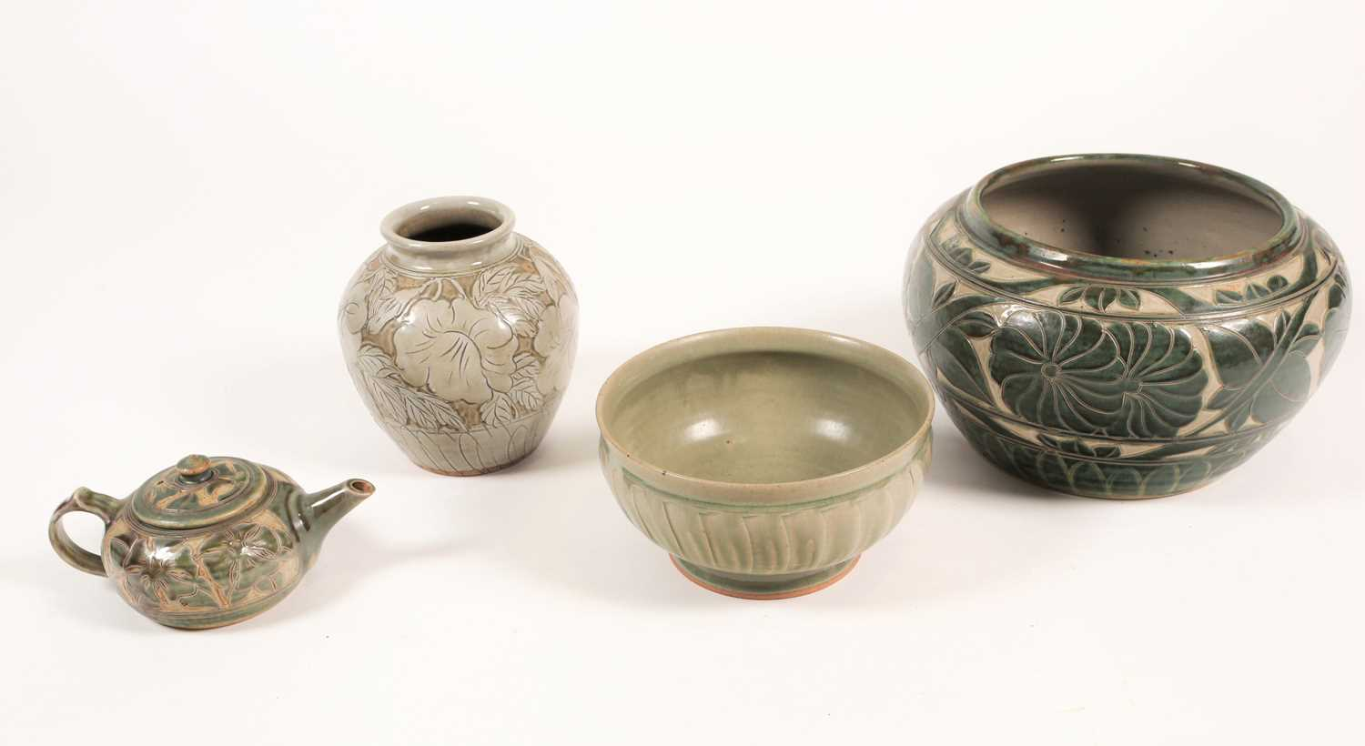 Four pieces of British studio pottery, comprising a jardiniere (19 cm high x 31 cm wide), a