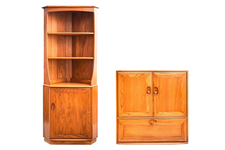 An Ercol golden dawn light elm free standing corner cupboard with an open upper section above a