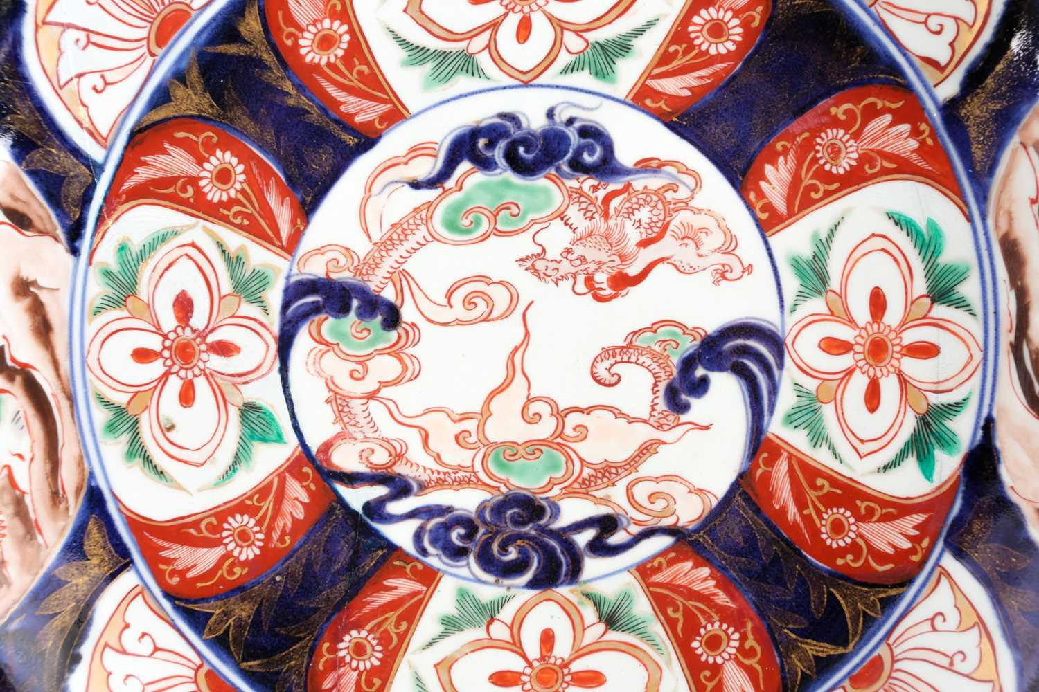 A large Japanese imari dished charger, Edo period, 18th century, painted to the centre with a dragon - Image 2 of 7