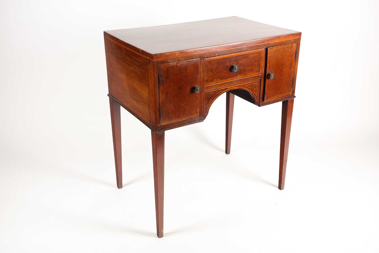 An Edwardian satinwood and tulipwood banded mahogany caddy topped kneehole dressing table with one