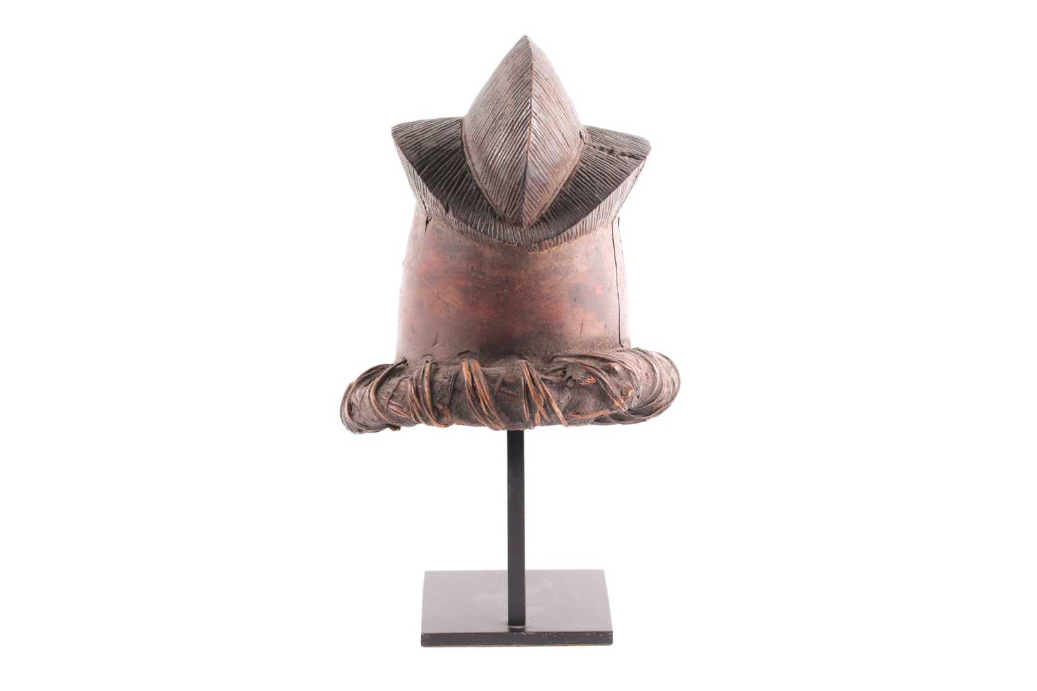 A small Baule helmet mask, Ivory Coast, the triple point coiffure with linear carving, with - Image 3 of 4