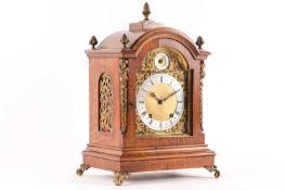A late 19th-century Winterhalder & Hofmeier eight-day bracket clock with a brass broken arch dial