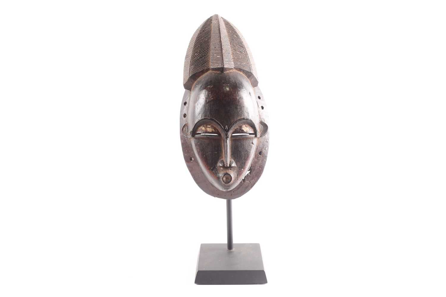 A Baule portrait mask, Gba Gba, Ivory Coast, the pointed coiffure with linear carving, above a large - Image 4 of 4
