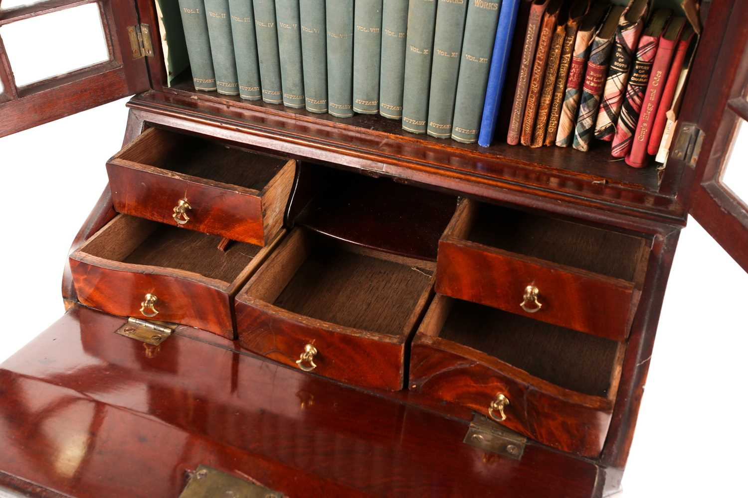A Chippendale style miniature mahogany bombe bureau bookcase. The upper section with arcaded - Image 2 of 7