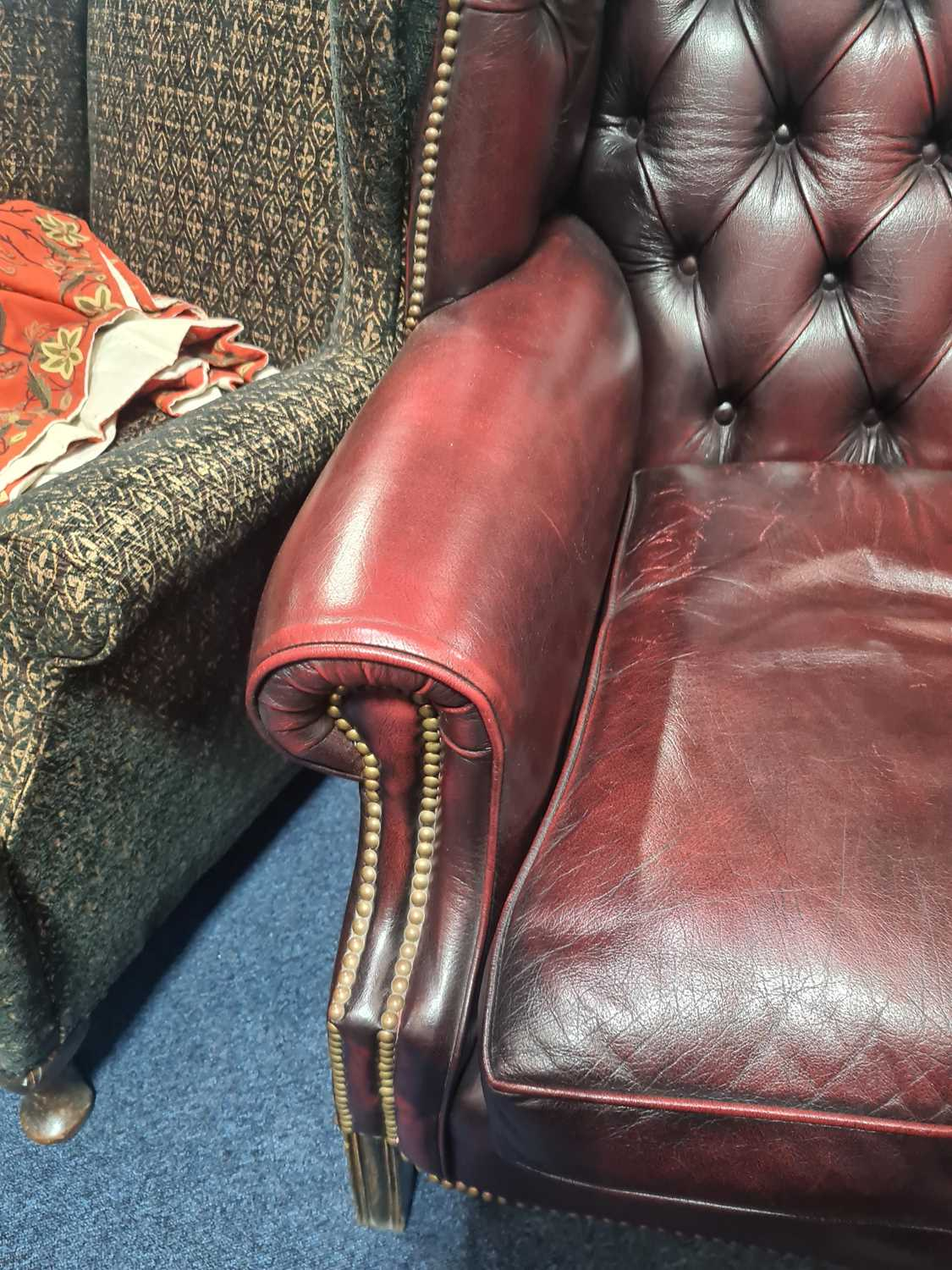 """A George III style deep button """"Ox Blood"""" hide upholstered hipped wing back fireside chair. With - Image 16 of 22"""