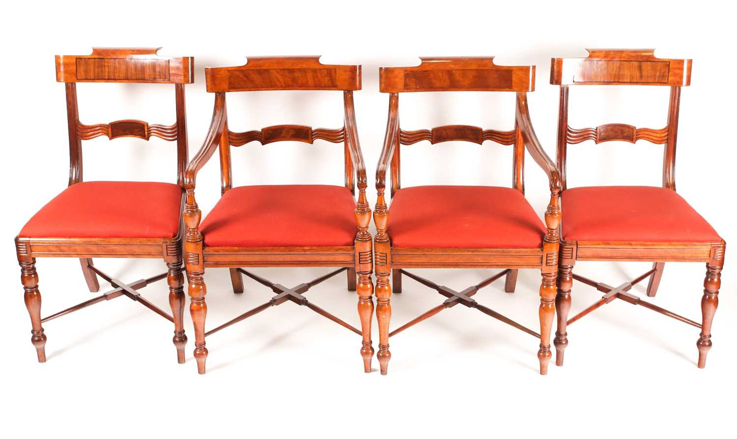A set of four Scottish Regency mahogany dining chairs. With broad, shaped cresting rails over