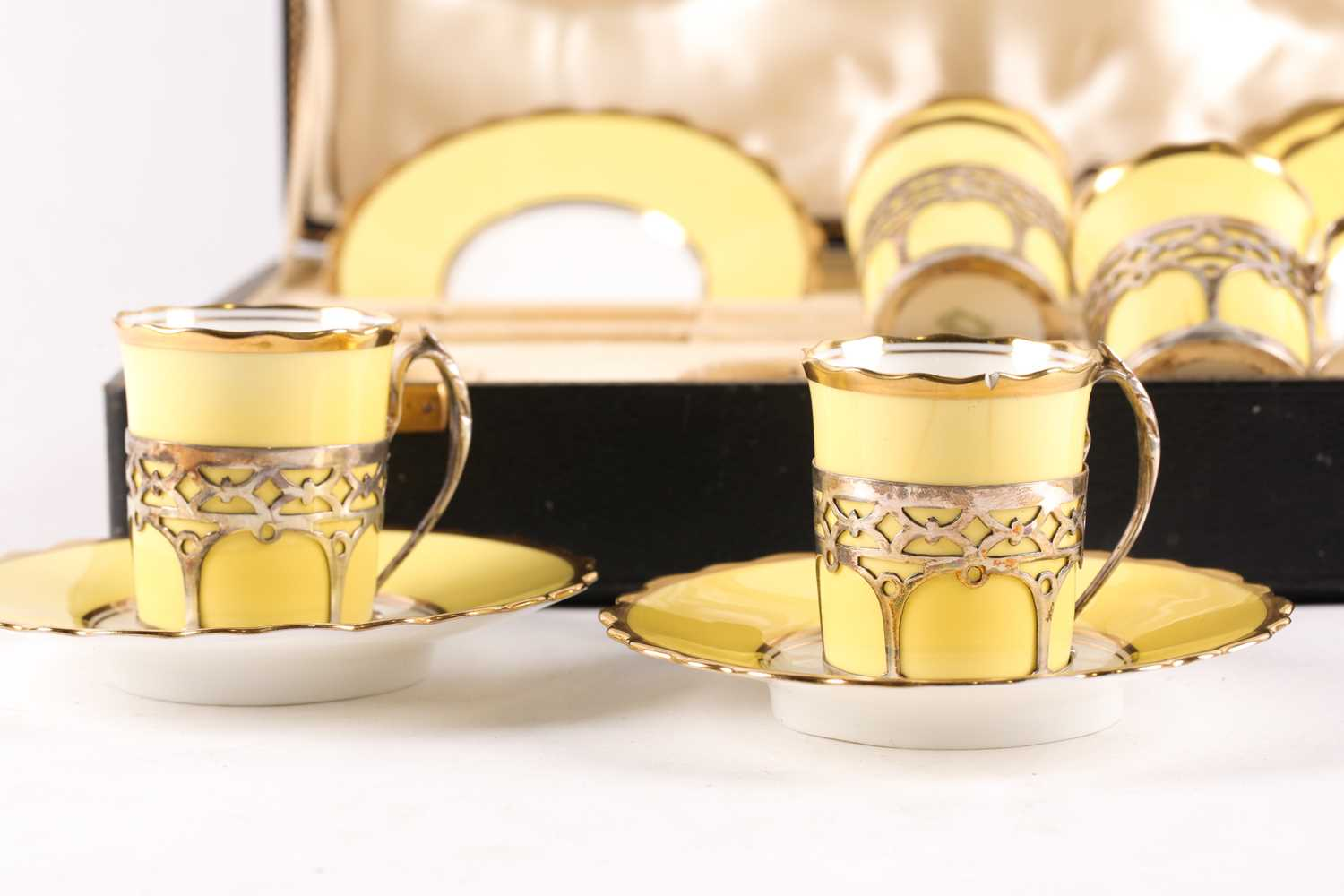 A set of six Aynsley bone china silver-mounted coffee cans and saucers, the two-tone yellow and - Image 3 of 4