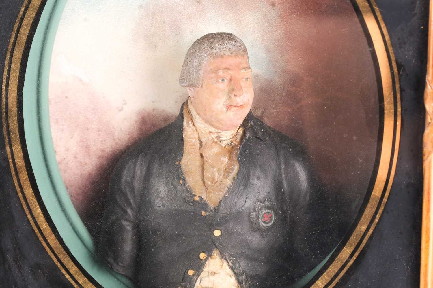 An 18th century painted relief wax half-length figure of George III, housed in a glazed gilt box - Image 2 of 4