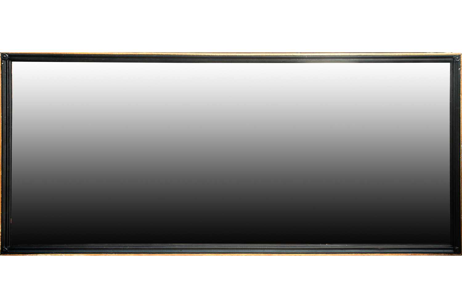 A very large 20th century rectangular ebonized and parcel gilt pier-glass/ wall mirror. With moulded
