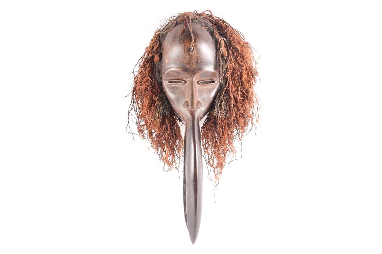 A Dan hornbill 'Kagle' mask, Liberia/Ivory Coast, the headdress of natural fibres, earth and