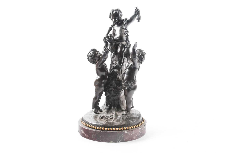 After J.C.Casimir, a 19th century patinated bronze sculpture, depicting three cherubs beside a
