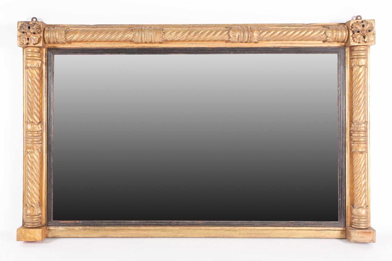 A Regency rectangular carved wood and gilt gesso overmantle mirror. With oak leaf Florette, split