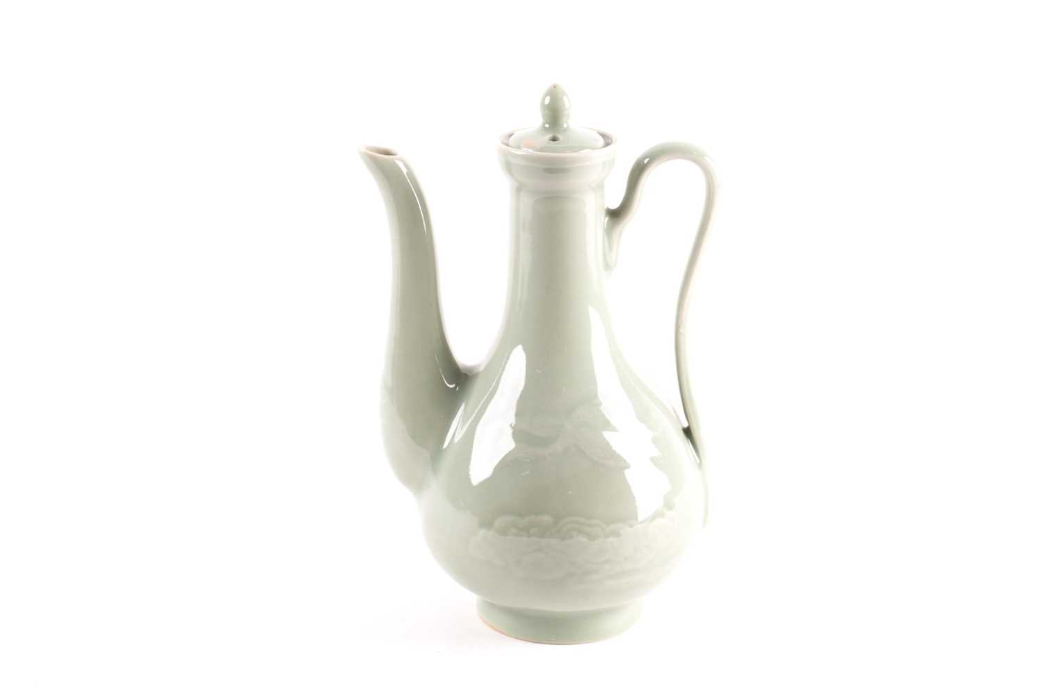 A Chinese celadon wine ewer, modelled in the Persian style, the long stopper with ball knop, moulded - Image 2 of 5