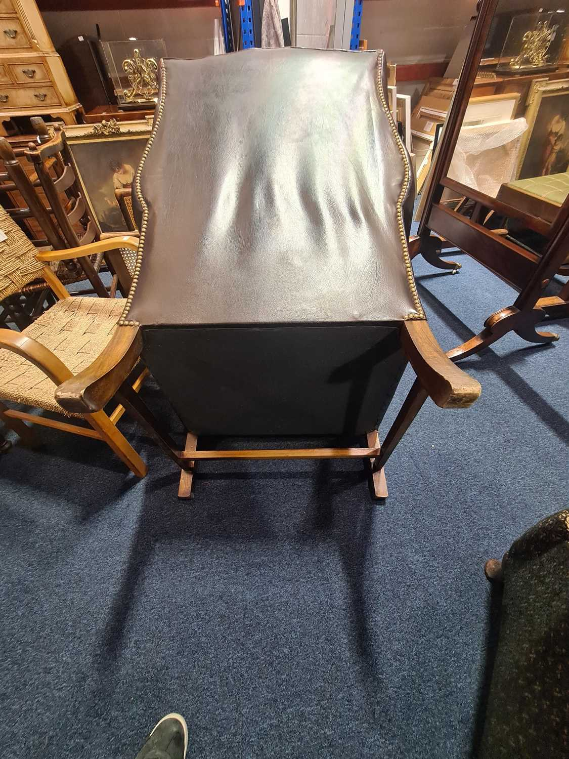 """A George III style deep button """"Ox Blood"""" hide upholstered hipped wing back fireside chair. With - Image 19 of 22"""