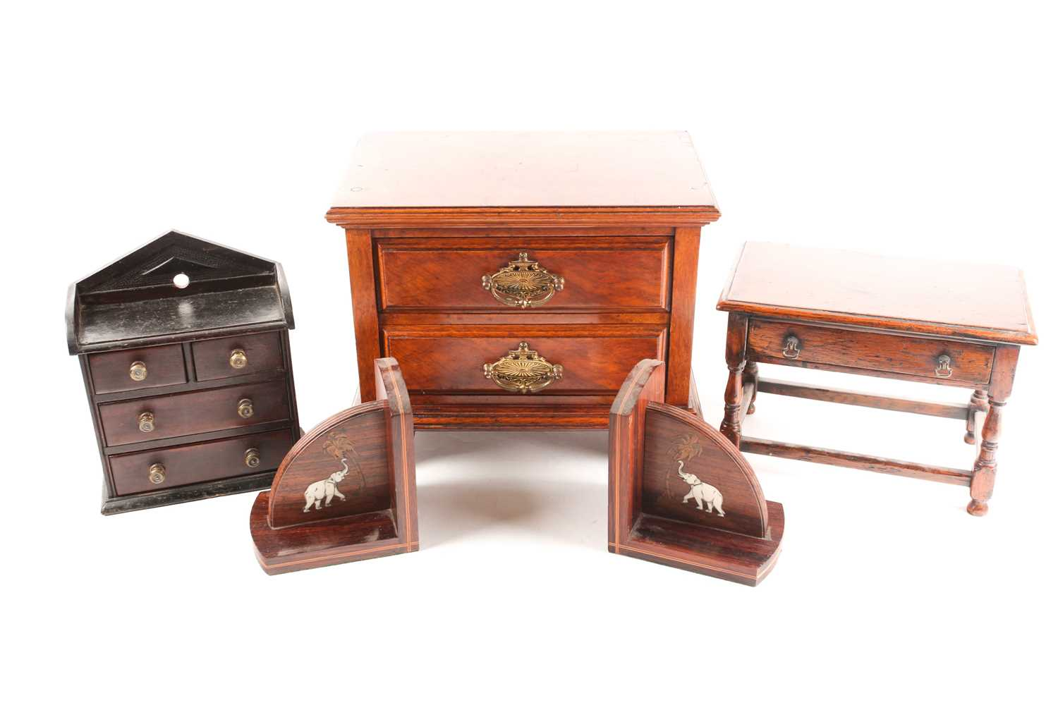 A Victorian apprentice piece chest of drawers, with pointed arch gallery back, the drawers with