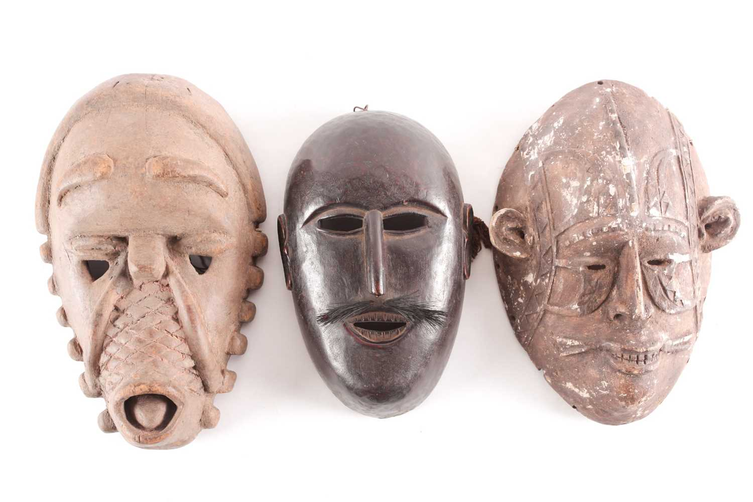 A Baule Monkey mask, Ivory Coast, the zoomorphic mask with large forehead and relief carved
