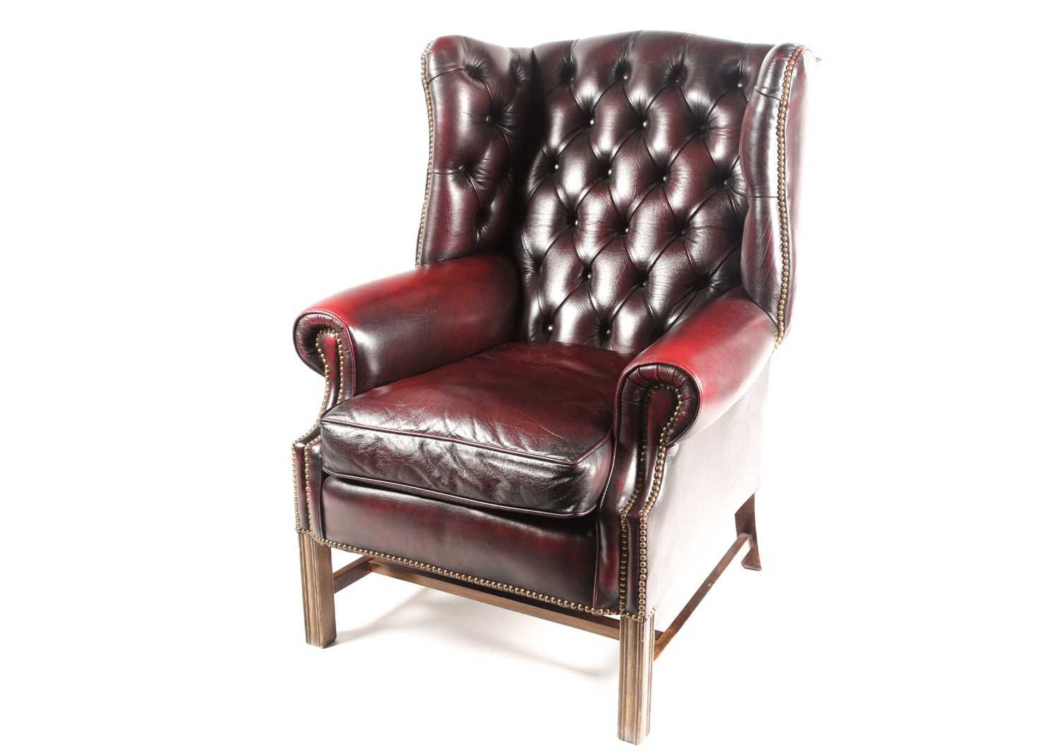 """A George III style deep button """"Ox Blood"""" hide upholstered hipped wing back fireside chair. With - Image 4 of 22"""