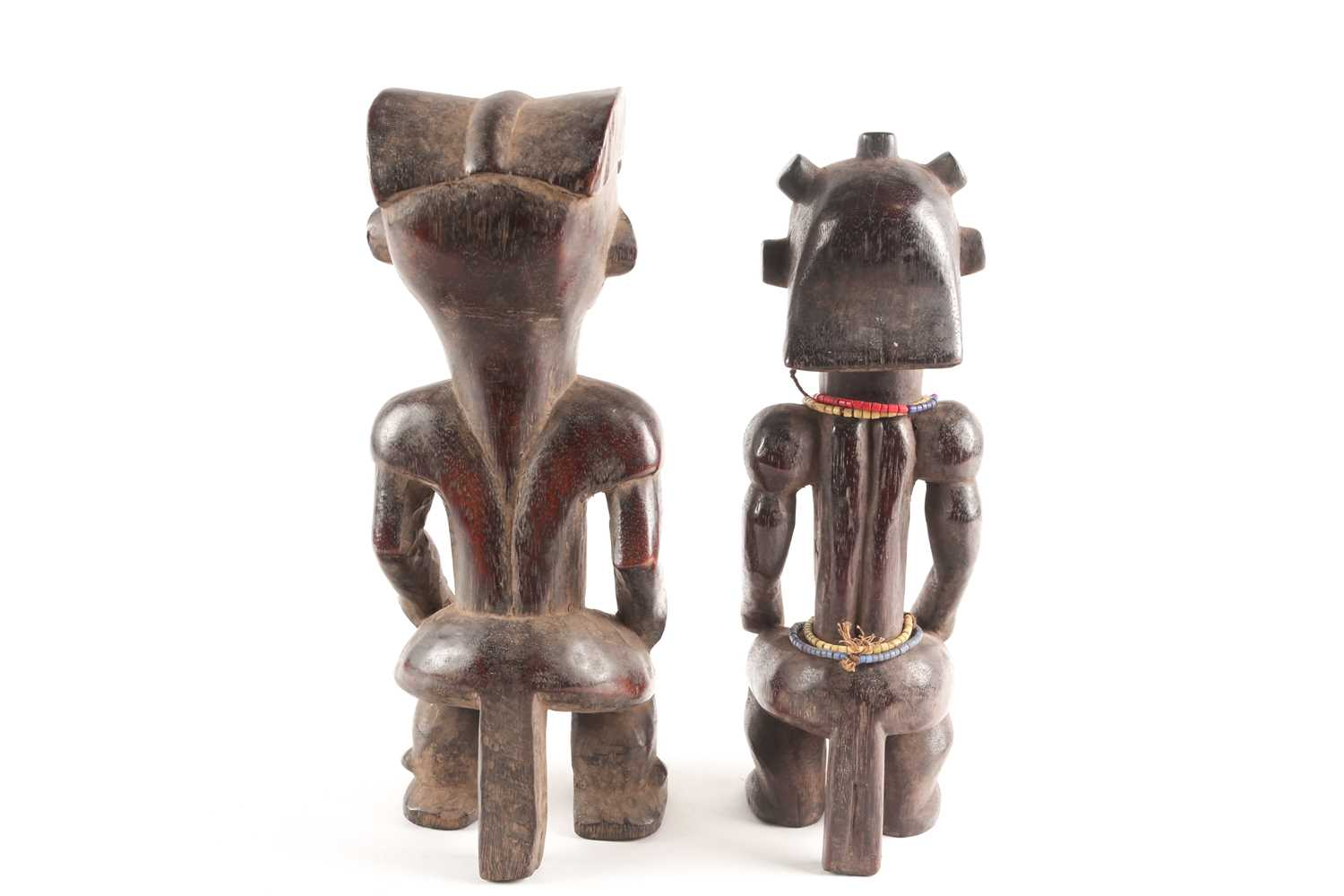 A Fang seated male figure, Gabon, with knotted hair swept out at the rear, seated with his hands - Image 5 of 6