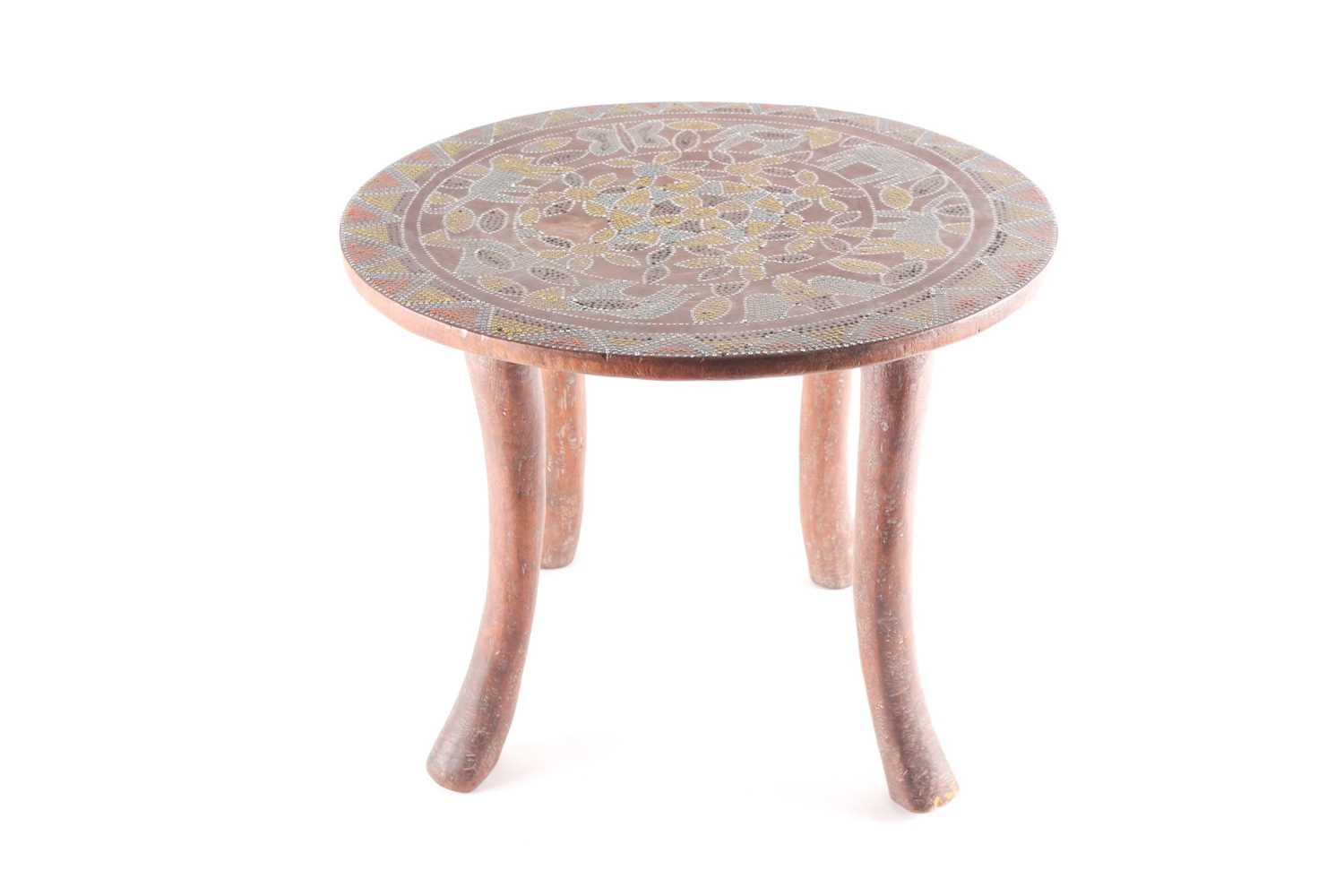A Kamba stool, Kenya, the circular top inlaid with coloured glass beads, decorated with flower,