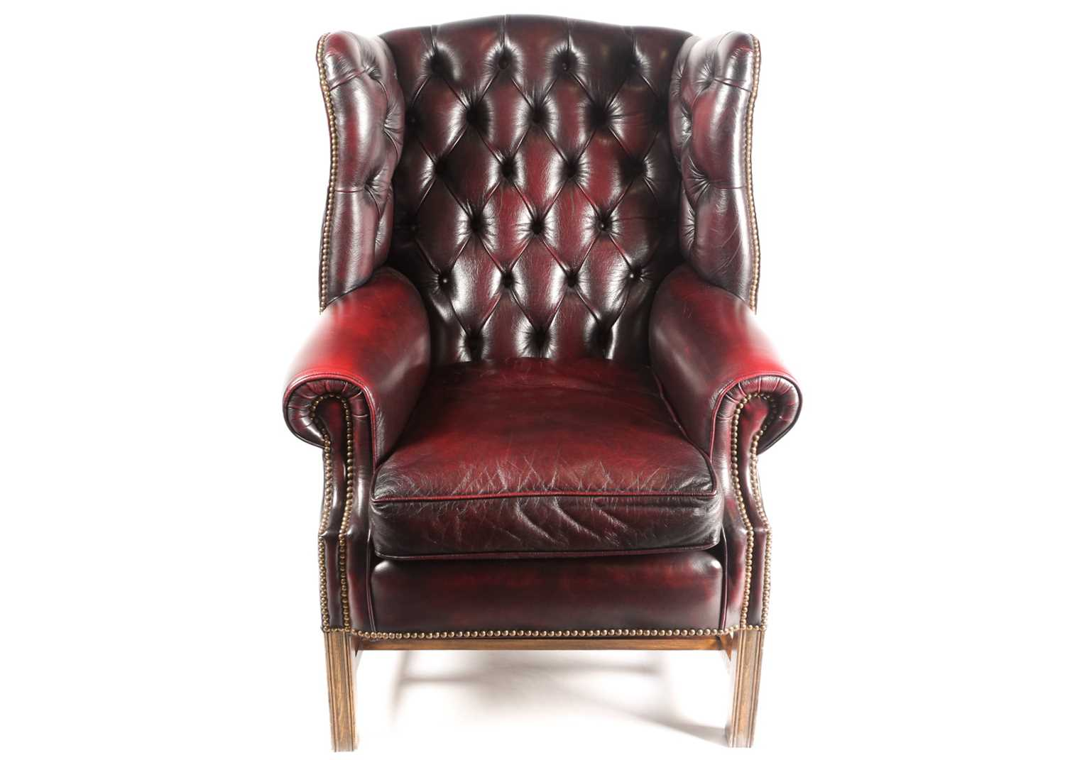 """A George III style deep button """"Ox Blood"""" hide upholstered hipped wing back fireside chair. With - Image 5 of 22"""