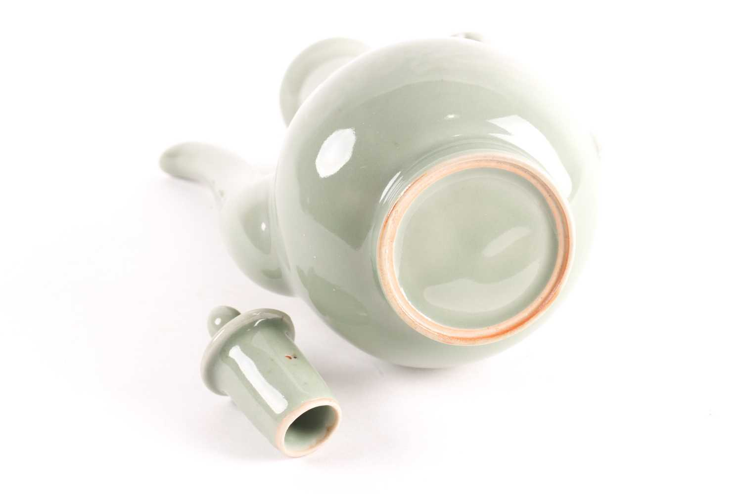 A Chinese celadon wine ewer, modelled in the Persian style, the long stopper with ball knop, moulded - Image 5 of 5