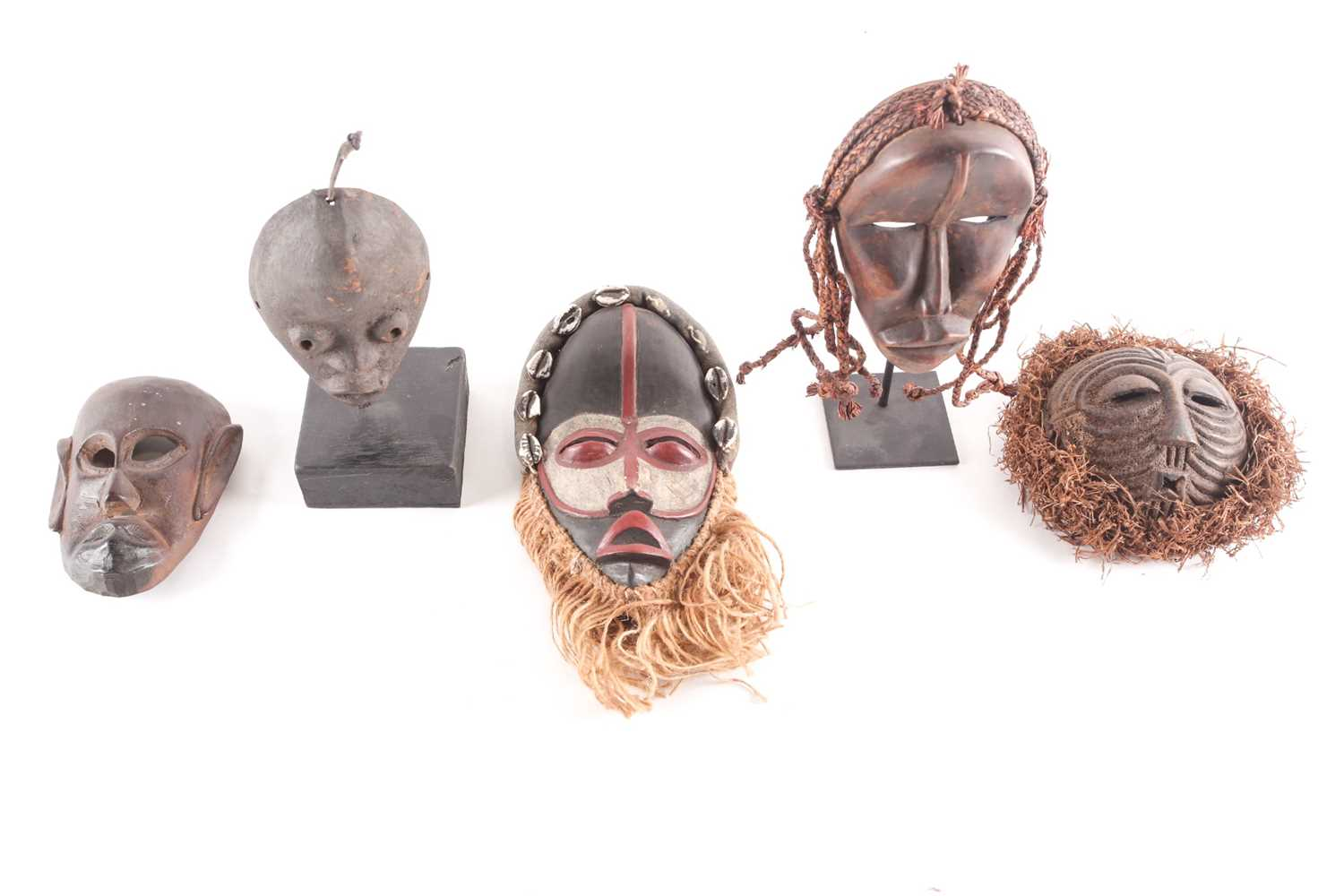Three Dan passport masks, Ivory coast, one with long woven natural fibres above a median line - Image 5 of 6