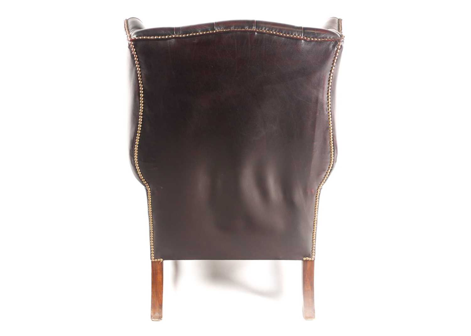 """A George III style deep button """"Ox Blood"""" hide upholstered hipped wing back fireside chair. With - Image 6 of 22"""