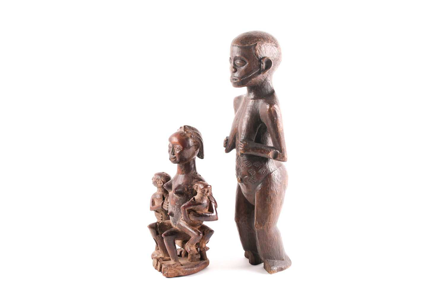 A Baule maternity figure, Ivory Coast, the smiling figure seated upon a stool and holding onto two - Image 3 of 4