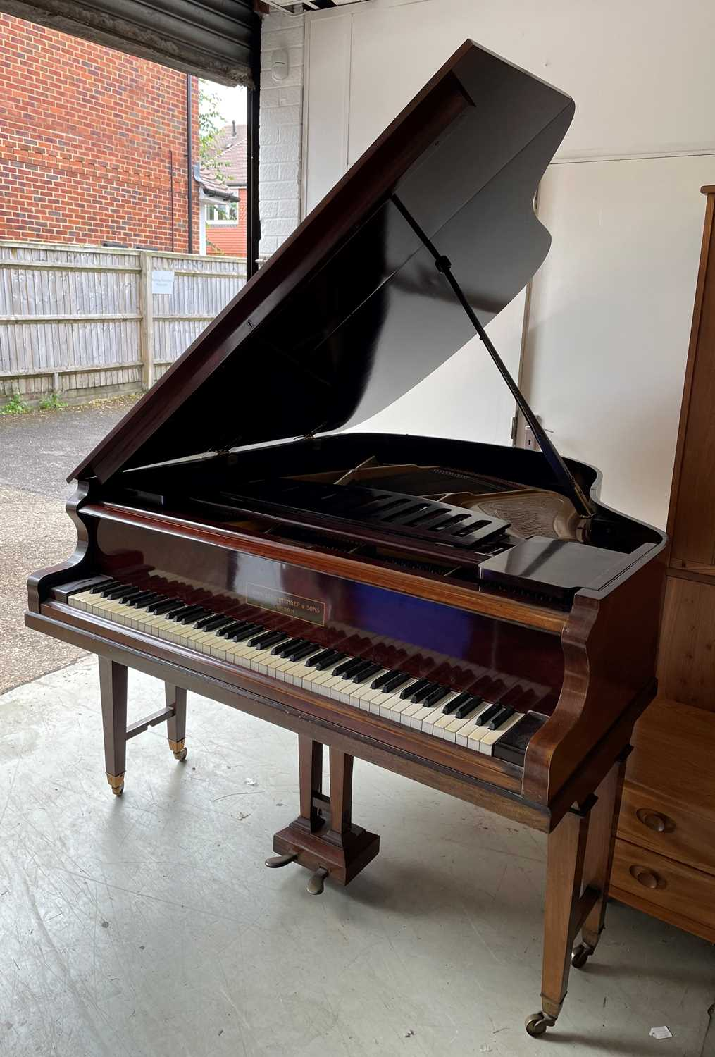 A mahogany cased baby grand piano, by John Strohmenger & Sons, London, 143 cm wide x 101 cm high x